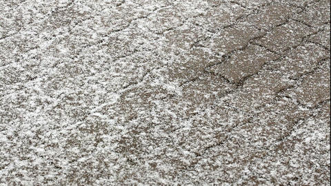 Time-lapse of snow falling on a pavement 1 Footage