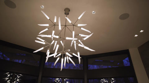 Abstract multi-arm spur grande chandelier in modern home Live Action