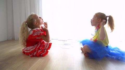Little girls or sisters training yoga together indoors. health concept Live Action