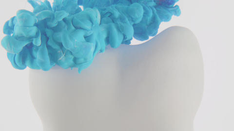 Dental Tooth Abstract, blue cloud covering it on a white background. Oral health Live Action