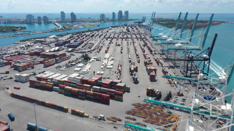 Hyper lapse above harbor dock revealing panorama on cargo port with Miami Beach Live Action