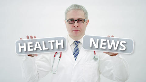 HEALTH NEWS text in doctor's hands Live Action