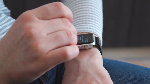 Smart watch on the girl's hand. Girl uses wrist smart watch Live Action