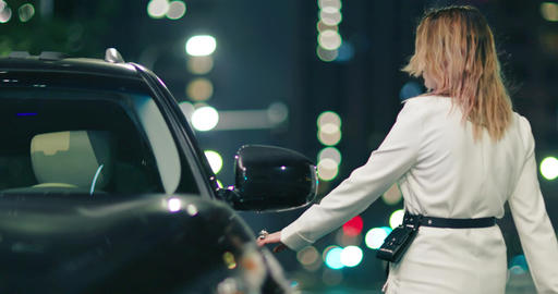 Portrait of stylish beautiful woman opening her car and starting SUV vehicle, 4K Live Action