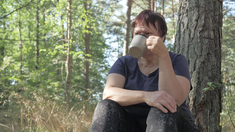 The lady drinking her coffee on a sunrise morning.4K Live Action