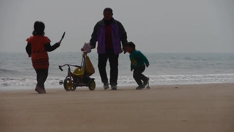 mother playing with kid on seaside Footage