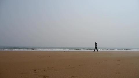 a girl alone walking on seaside Stock Video Footage