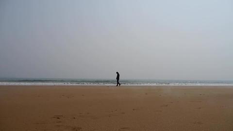 a depression man alone walking on seaside Stock Video Footage