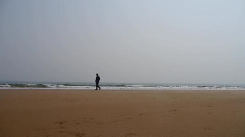 a depression man alone walking on seaside Footage