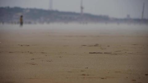 wind blowing mist over beach,against mirage Footage