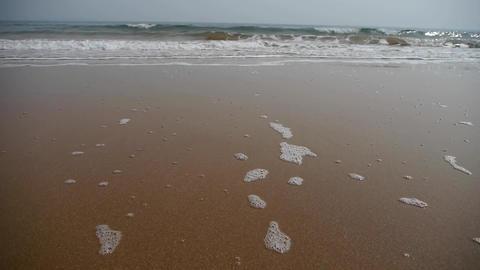 timelapse tidal,Ocean waves on the golden beach Stock Video Footage