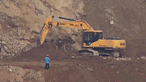 excavator working & dumper truck on construction site Stock Video Footage