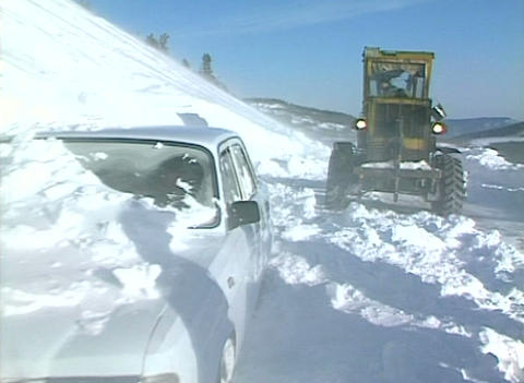 Snow storm, People overcome snowstorm Stock Video Footage