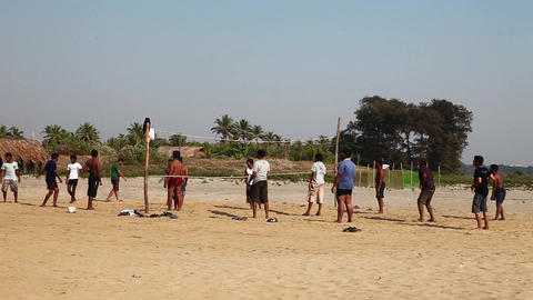Playing volleyball on the ocean beach Stock Video Footage