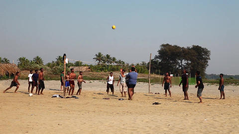 Playing Volleyball On The Ocean Beach stock footage