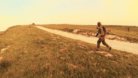 armed soldiers walking through field. soldiers running... Stock Video Footage