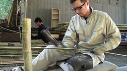 Workers are cutting and smoothening bamboo trees i Stock Video Footage