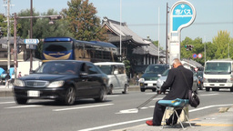 An elderly man waits for the bus in Kyoto, Japan Footage