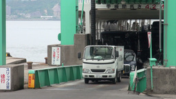 Cars exit a large ferry in Japan Stock Video Footage