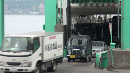 Cars exit a large ferry in Japan Footage
