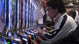 Japanese people play on 'pachinko' machines, fulfi Footage