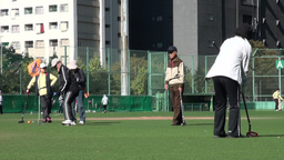 Japanese elderly play gateball in Tokyo Stock Video Footage
