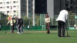 Japanese elderly play gateball in Tokyo Stock Video Footage