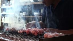 Fresh yakitori (chicken kebabs) in Japanese izakay Stock Video Footage
