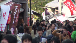 Shops and commercial banners in a busy tourist str Footage