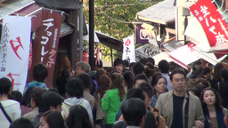 Shops and commercial banners in a busy tourist str Stock Video Footage