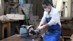 Sharpening long knife at the Tsukiji fish market i Stock Video Footage