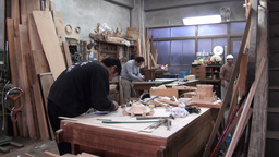 Preparing wooden miniature temples in a workshop i Stock Video Footage