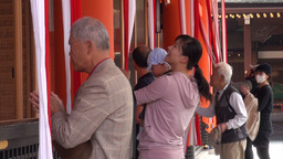 Elderly man and family are praying at the Fushimi Stock Video Footage