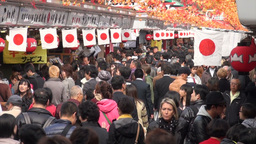 People walking through busy tourist shopping stree Stock Video Footage