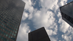 Office towers in Tokyo with clouds, time lapse Stock Video Footage