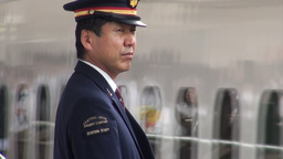 Shinkansen station staff and arriving bullet train Stock Video Footage