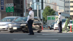 Traffic police on busy crossing in Japanese city Footage