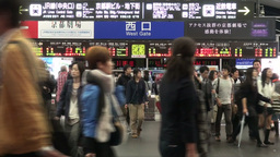 Passengers exit gates of a busy Kyoto train statio Stock Video Footage