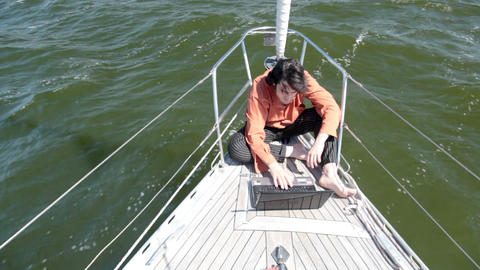 With laptop on a yacht Stock Video Footage