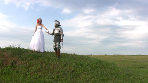 Knight and bride coming down the hill Stock Video Footage