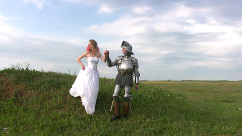 Knight And Bride Coming Down The Hill stock footage