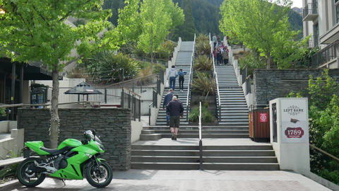 Tourist walk at staircase connect to other tourism spot Live Action