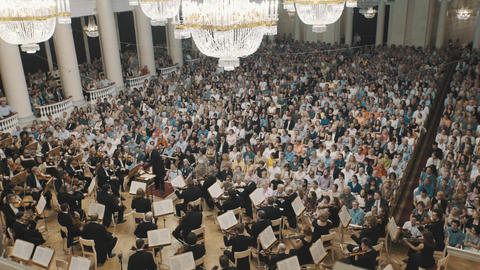 Overview of old style music hall during string orchestra concert. Lot of people Live Action