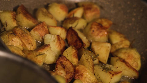 Potatoes are fried in the pan Live Action