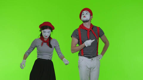 Mimes Smoke On A Green Background. Mimes Actors On Green Background Live Action