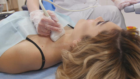 Female Doctor Taking A Sonogram Of Female Patients Neck In The Hospital Live Action