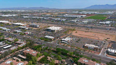 Aerial overlooking small desert small town a Avondale city of rugged mountains Live Action
