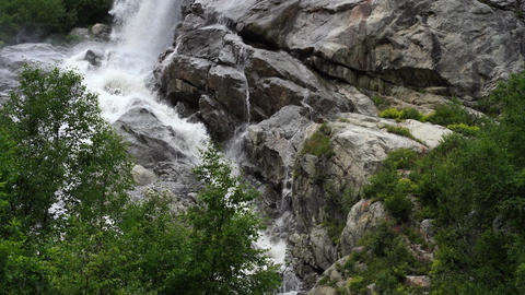 Beautiful landscape of big waterfall in cloudy weather. Mountain waterway with Live Action