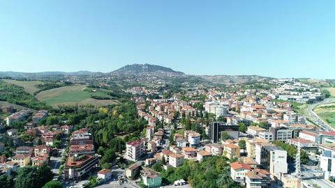 SRL world trade center building and other business buildings on a hill in San Marino Italy Live Action