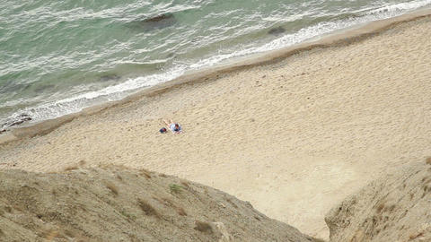 man is resting on the beach Live Action